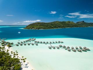 Aerial image from a drone of blue lagoon and Otemanu mountain at Bora Bora island, Tahiti, French...
