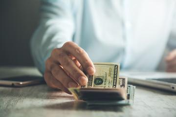 man hand money on table