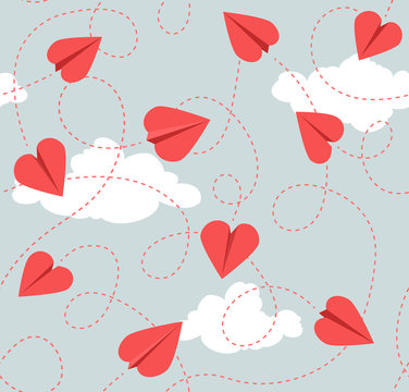 Seamless Valentines Day pattern of heart shaped paper airplanes. Flying red hearts on grey background.  Vector Illustration