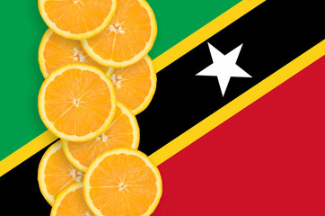 Saint Kitts and Nevis flag and citrus fruit slices vertical row