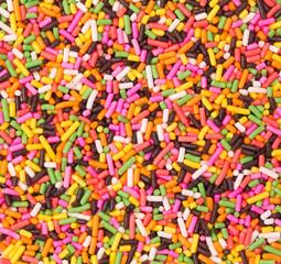 background of multi colored sprinkles sugar