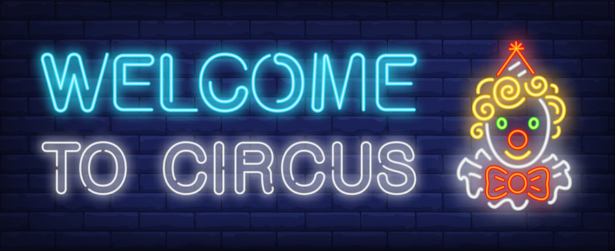 Welcome to circus neon text with funny clown head. Circus performance advertisement design. Night bright neon sign, colorful billboard, light banner. Vector illustration in neon style.