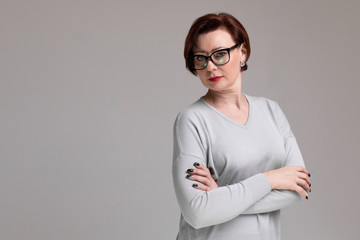 Portrait of beautiful woman with glasses isolated on light background