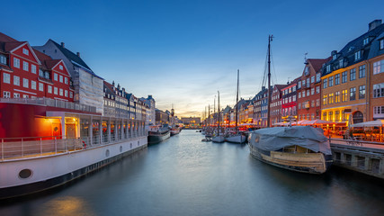 Wall Mural - Copenhagen city at night with view of Nyhavn in Denmark