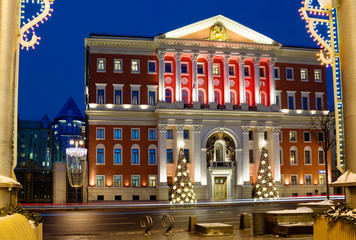Moscow, Russia, New Year at the city hall. The city hall is designed in red and white. The Central part of the building is allocated 8-column portico with pediment.