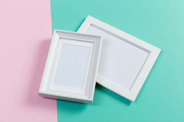 white frames on pink and menthol background