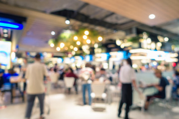 Abstract blurred defocusing of food court in the mall., Motion blurry image inside of department store., Business customer service.