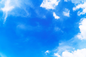 The sky is blue and the wind blows to change the direction and formation of the white fluffy clouds which create a wonderful background and copy space in the air.