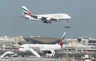 Emirates Airlines Airbus A380 plane approaches for landing at Dubai Airports in Dubai