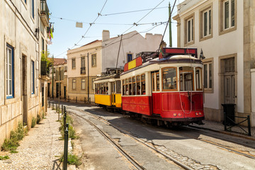 Keuken foto achterwand Milan Yellow and red tram on old streets of Lisbon, Alfama, Portugal, popular touristic attraction and destination.