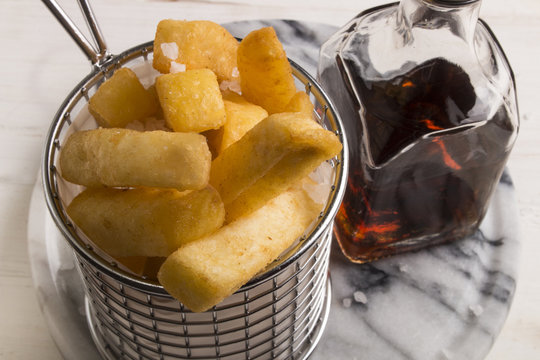 french fries in a serving basket, served with malt vinegar