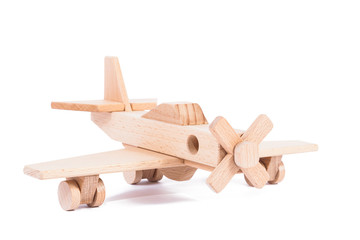 Photo of a wooden plane  of beech. Toy made of wood retro aircraft on a white isolated background