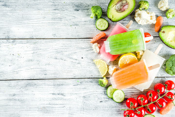 Trendy vegan food, vegetable ice cream popsicles, avocado, cucumber, tomato, beet, carrot, broccoli, cauliflower creamy gelato. Dietary healthy lifestyle, summer cold dessert.