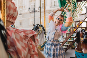 Street performer dancing on carousel