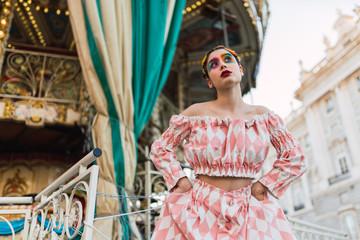 Street performer standing on carousel