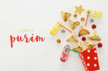 Purim celebration concept (jewish carnival holiday) over wooden white background.