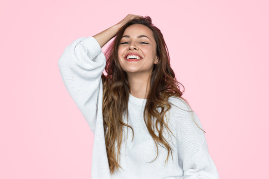 Laughing teenage girl in white sweatshirt