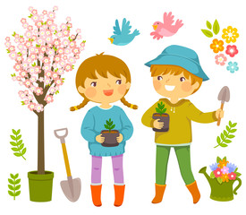 Kids with gardening tools and saplings to plant on Tu Bishvat.