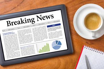Tablet on a desk - Breaking News