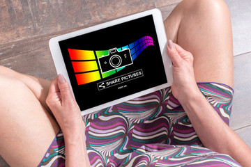 Pictures sharing concept on a tablet
