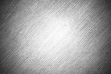 Texture background gray sheet metal with scratches. Polished steel plate.