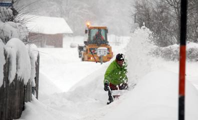 A man uses a snow blower after heavy snowfalls near Irschenberg