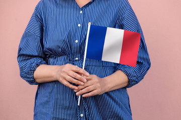 France flag. Close up of a woman's hands holding French flag.