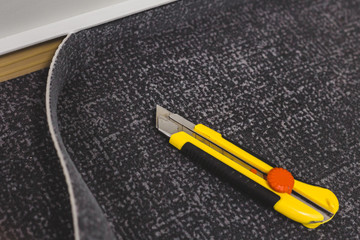 Repair and finishing work in the interior - laying carpet