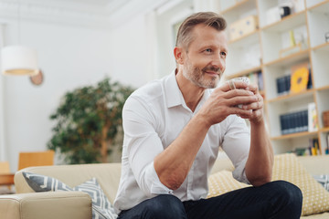 Thoughtful man enjoying a relaxing coffee