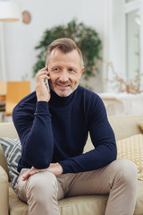 Middle-aged man listening to a phone call