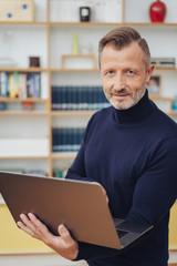 Businessman using a handheld laptop computer