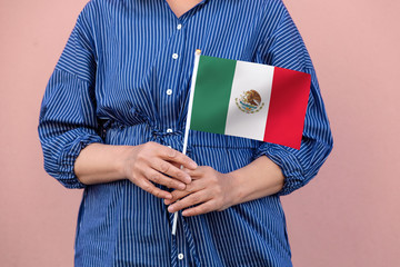 Mexico flag. Close up of woman's hands holding Mexican flag.