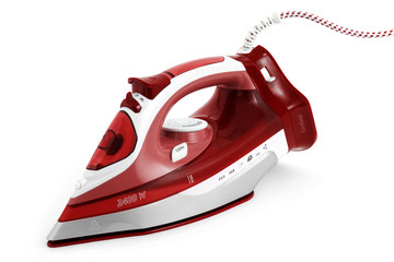 Steam iron laid on white background, red type