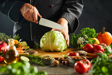 Chef preparing to slice a fresh cabbage