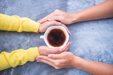 A cup of tea in the hands. Selective focus. Drink