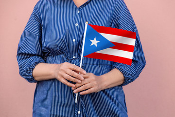 Puerto Rico flag. Close up of a woman's hands holding Puerto Rican flag.