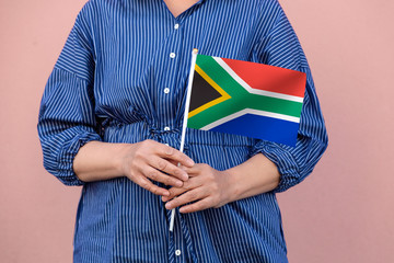 South Africa flag. Close up of a woman's hands holding South Africa flag.