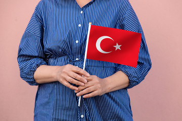 Turkey flag. Close up of a woman's hands holding Turkey flag.