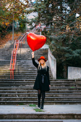 Blonde Woman Holding Red Heart Shaped Balloon