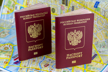 Travel concept. Two Russian passports on the background of a paper map of the city