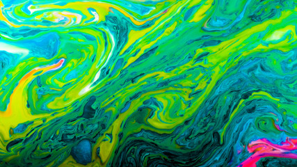 Green psychedelic abstract bright colors are mixed in a liquid