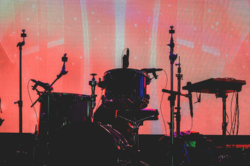 Silhouette set of musical instruments during concert.