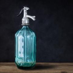 vintage turquoise soda glass bottle