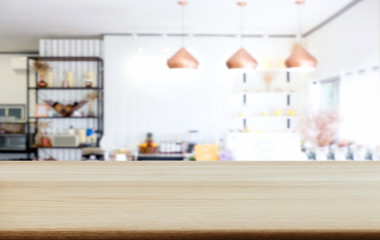 Empty wooden table and blurred background of abstract in front of coffee shop or restaurant for display of product or for montage