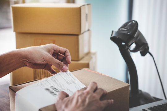 Home delivery service and working service mind, Woman working install serial barcode to confirm before sending customer in post office