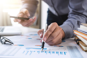 Business Financing Accounting Banking Concept, businessman using smart phone and doing finances, calculate about cost to real estate investment and in other, tax system