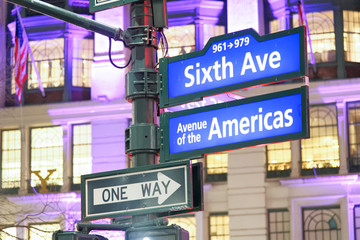 Sixth Avenue - Avenue of the Americas sign at night in Manhattan, New York City