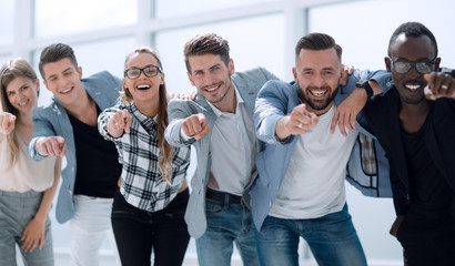 Group of people pointing at the camera and smiling - isolated