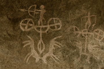 the image of an ancient man on the wall of the cave. history of antiquities, archeology.