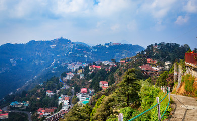 An Aerial landscape view of Mussoorie or Mussouri hill top peak city located in Uttarakhand India with colorful buildings